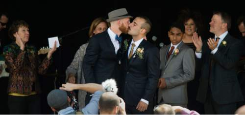 Steve Griffin  |  The Salt Lake Tribune Derek Kitchen and Moudi Sbeity, the lead plaintiffs from the landmark Utah case that legalized same-sex marriage, kiss after being announced as husband and husband by friend and minister Nan Seymour during their public marriage ceremony at the Gallivan Center Plaza in Salt Lake City, Sunday, May 24, 2015.