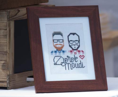 Steve Griffin  |  The Salt Lake Tribune A framed needlepoint of Derek Kitchen and Moudi Sbeity, the lead plaintiffs from the landmark Utah case that legalized same-sex marriage, during their marriage at the Gallivan Center Plaza in Salt Lake City, Sunday, May 24, 2015.