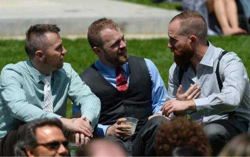Steve Griffin  |  The Salt Lake Tribune Friends, family and supporters attend Derek Kitchen and Moudi Sbeity's marriage ceremony at the Gallivan Center Plaza in Salt Lake City, Sunday, May 24, 2015.