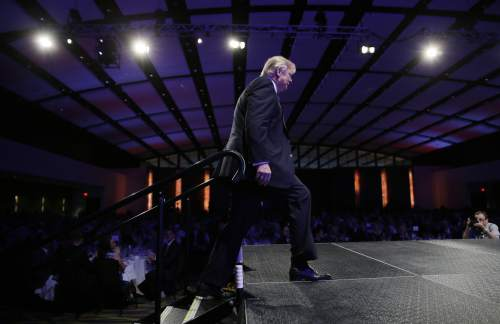 Donald Trump walks on stage to speak during the Iowa Republican Party's Lincoln Dinner, Saturday, May 16, 2015, in Des Moines, Iowa. (AP Photo/Charlie Neibergall)