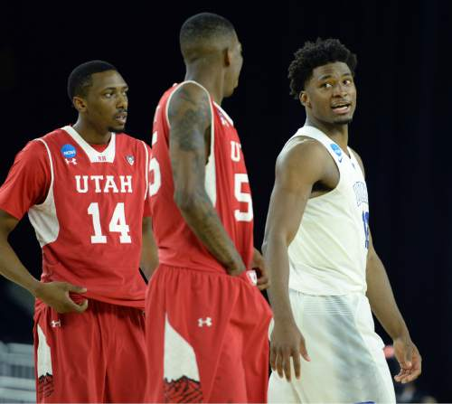 Steve Griffin  |  The Salt Lake Tribune  Duke Blue Devils forward Justise Winslow (12), right, and Utah Utes guard Delon Wright (55) exchange words at the end of the the University of Utah versus Duke University Sweet 16 game in the 2015 NCAA Men's Basketball Championship Regional Semifinal game at NRG Stadium in Houston, Friday, March 27, 2015.