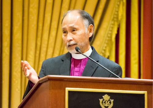 Rick Egan  |  The Salt Lake Tribune The Rev. Scott B. Hayashi, bishop of the Episcopal Diocese of Utah, speaks during a reception for departing Archbishop John C. Wester at the Little America on Sunday, May 31, 2015.