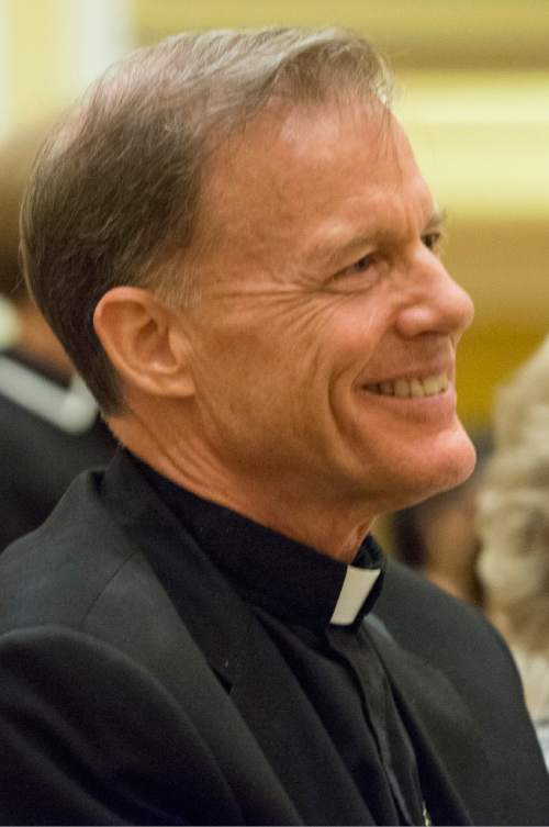 Rick Egan  |  The Salt Lake Tribune  Archbishop John C. Wester listens to the Rev. Scott B. Hayashi, bishop of the Episcopal Diocese of Utah, during a reception at the Little America, Sunday, May 31, 2015.