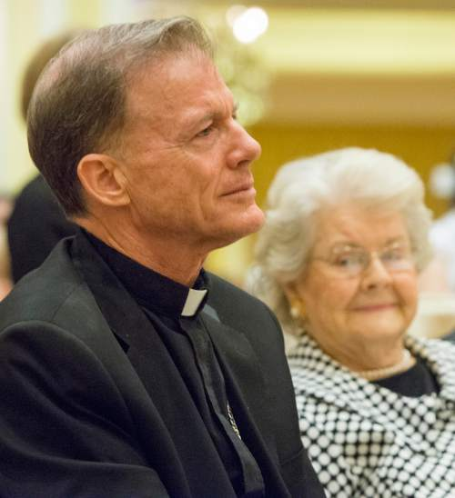 Rick Egan  |  The Salt Lake Tribune  Archbishop John Wester listens as the Rev. Scott B. Hayashi, bishop of the Episcopal Diocese of Utah, speaks during a reception at the Little America, Sunday, May 31, 2015.