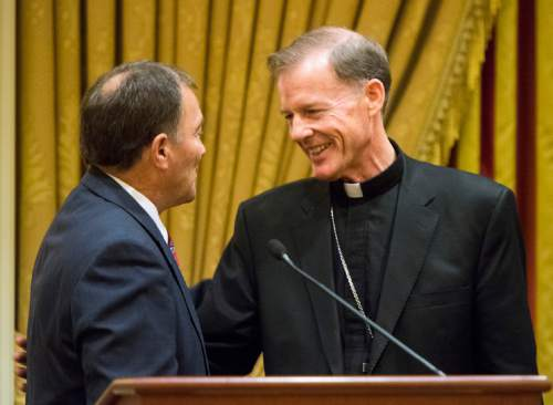 Rick Egan  |  The Salt Lake Tribune  Gov. Gary Herbert visits with departing Archbishop John C. Wester at the Little America on Sunday, May 31, 2015.