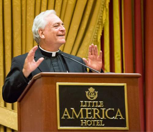 Rick Egan  |  The Salt Lake Tribune The Rev. Martin Diaz, pastor of the Cathedral of the Madeleine, speaks speaks at a reception for departing Archbishop John C. Wester at the Little America on Sunday, May 31, 2015.
