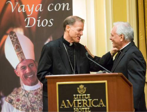 Rick Egan  |  The Salt Lake Tribune Archbishop John C. Wester shakes hands with the Rev. Martin Diaz, pastor  of the Cathedral of the Madeleine, at a reception at the Little America on Sunday, May 31, 2015.