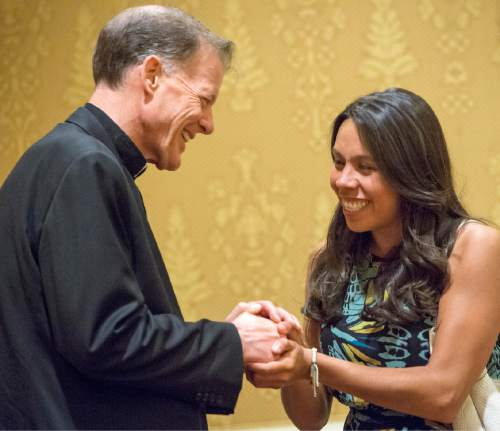 Rick Egan  |  The Salt Lake Tribune  Amee Garcia vists with departing Archbishop John C. Wester at the Little America on Sunday, May 31, 2015.