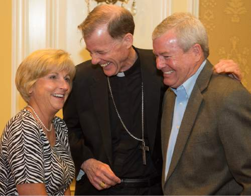 Rick Egan  |  The Salt Lake Tribune  Lynn and John Wilson visit with departing Archbishop John C. Wester at the Little America on Sunday, May 31, 2015.