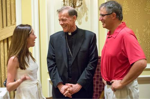 Rick Egan  |  The Salt Lake Tribune  Jodi and Jeff Gross visit with departing Archbishop John C. Wester at the Little America on Sunday, May 31, 2015.
