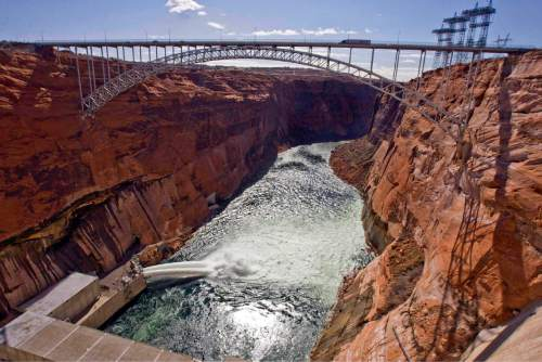 Paul Fraughton  | Tribune file photo Valves at the base of the Glen Canyon Dam are opened in March 2008.