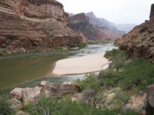 "Matt Kaplinski  |  Northern Arizona University  Experimental high-flow releases or ""floods"" from Glen Canyon Dam are helping restore the Colorado River's sandbars in the Grand Canyon."