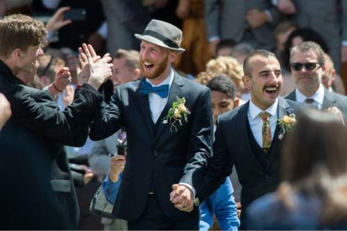 Steve Griffin  |  The Salt Lake Tribune Derek Kitchen and Moudi Sbeity, the lead plaintiffs from the landmark Utah case that legalized same-sex marriage, hold hands as they walk up the aisle after getting married in a large public ceremony at the Gallivan Center Plaza in Salt Lake City, Sunday, May 24, 2015.