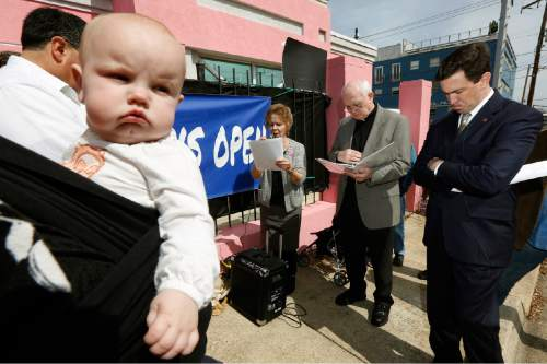 This photo taken March 5, 2014 shows seven-month old Abigail Dalton of Ridgeland, seeming to be listening as state Mississippi Sen. Chris McDaniel, R-Ellisville, right, prays with fellow abortion opponents, Laura Duran of Pro-Life Mississippi, left, and Rev. Mike O'Brien, pastor of St. Richard Catholic Church in Jackson, center,  outside the Jackson Women's Health Organization clinic in Jackson, Miss., during the first day of a 40-day pro-life mobilization outside the only facility in the state that still performs abortions. Abortions have declined in states where new laws make it harder to have them - but they've also waned in states where abortion rights are protected, an Associated Press survey finds. Nearly everywhere, in red states and blue, abortions are down since 2010. (AP Photo/Rogelio V. Solis)