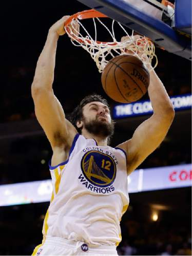 Golden State Warriors center Andrew Bogut (12) dunks against the Cleveland Cavaliers during the second half of Game 1 of basketball's NBA Finals in Oakland, Calif., Thursday, June 4, 2015. (AP Photo/Ben Margot)