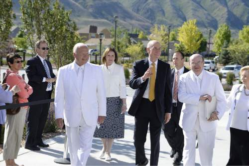 (Courtesy of the LDS Church)  President Henry B. Eyring, first counselor in the First Presidency of The Church of Jesus Christ of Latter-day Saints, arrives with Elder Kent F. Richards (left) of the Seventy and executive director of the Church's Temple Department and Elder Quentin L. Cook (right) of the Quorum of the Twelve Apostles, for the dedication of the Payson Utah Temple, the church's 146th temple in the world, on Sunday, June 7, 2015.
