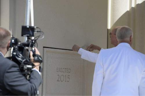 (Courtesy of the LDS Church)  President Henry B. Eyring, first counselor in the First Presidency of the Church, places mud around the cornerstone of the Payson Utah Temple signaling the temple is complete. He also dedicated the sacred edifice.