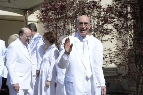 (Courtesy of the LDS Church)  Cheerfully waving to the crowd at the cornerstone ceremony of the Payson Utah Temple is President Henry B. Eyring, first counselor in the First Presidency of the church.