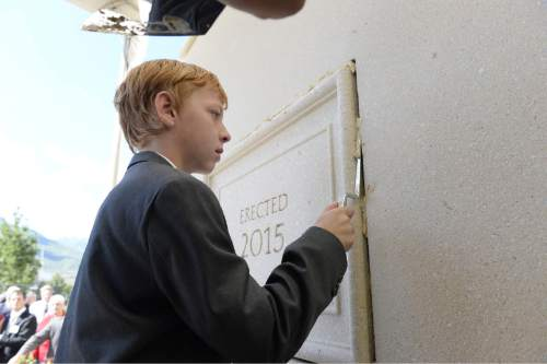 (Courtesy of the LDS Church)  Children were offered the opportunity to make history by securing the cornerstone in place at the Payson Utah Temple on Sunday, June 7, 2015.