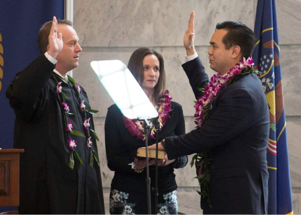 Steve Griffin  |  Tribune file photo  Attorney General Sean Reyes stands with his wife, Saysha, as he takes the oath of office administered by Utah Supreme Court  Justice Thomas R. Lee during his inaugural program in the Utah Capitol Rotunda in Salt Lake City, Monday, Jan. 5, 2015.