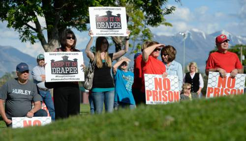 Francisco Kjolseth  |  The Salt Lake Tribune  Public officials and residents opposed to moving the prison to Tooele rally at the Grantsville City Park, while the Prison Relocation Commission holds its public meeting at the high school across the street on Thursday, May 28, 2015.