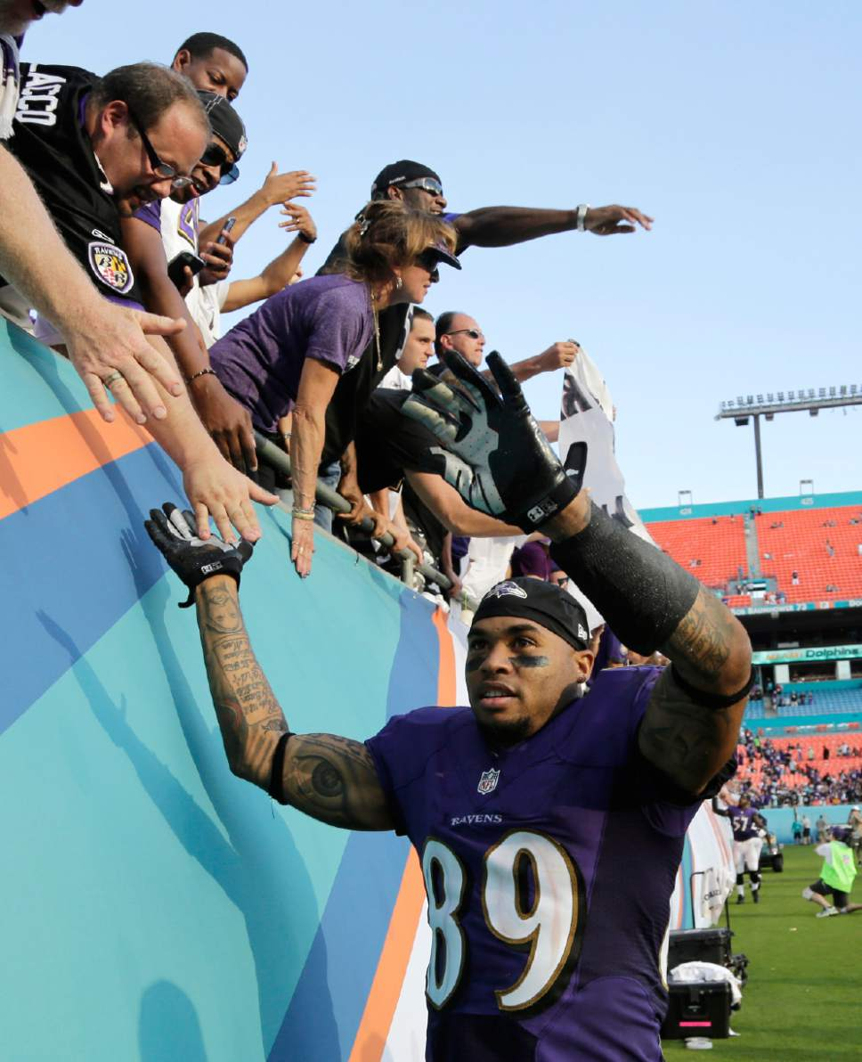 Baltimore Ravens wide receiver Steve Smith (89) shakes hands with the fans after an NFL football game against the Miami Dolphins, Sunday, Dec. 7, 2014, in Miami Gardens, Fla.  The Ravens defeated the Dolphins 28-13. (AP Photo/Lynne Sladky)