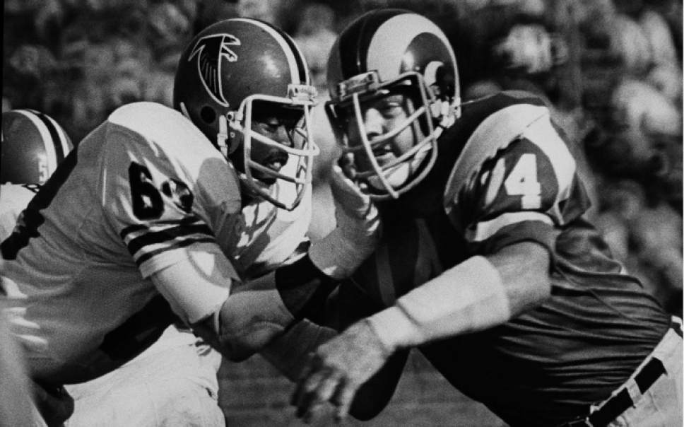 Merlin Olsen, right, of the Los Angeles Rams, battles Atlanta guard Gregg Kindle in Olsen's final regular-season game with in Los Angeles on Dec. 4, 1976. The 6-foot-5- inch, 270-pound star is retiring with a club record of 207 games. The Rams won 59-0 to take their fourth striaght National Football Conference Western Division title. (AP Photo)