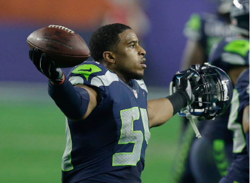 Seattle Seahawks middle linebacker Bobby Wagner (54) celebrates after intercepting New England Patriots quarterback Tom Brady during the second half of NFL Super Bowl XLIX football game Sunday, Feb. 1, 2015, in Glendale, Ariz. (AP Photo/Brynn Anderson)