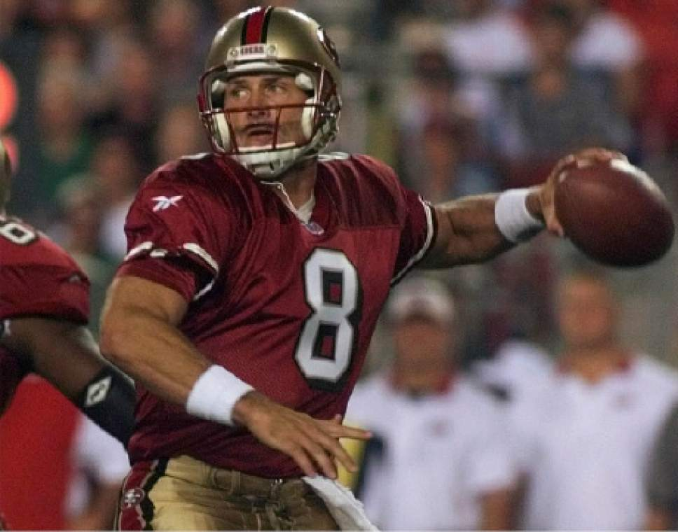 San Francisco 49ers quarterback Steve Young gets ready to pass against the Washington Redskins during first quarter action at Jack Kent Cooke Stadium in Landover, Md., Monday, Sept.14, 1998.  (AP Photo/Doug Mills)