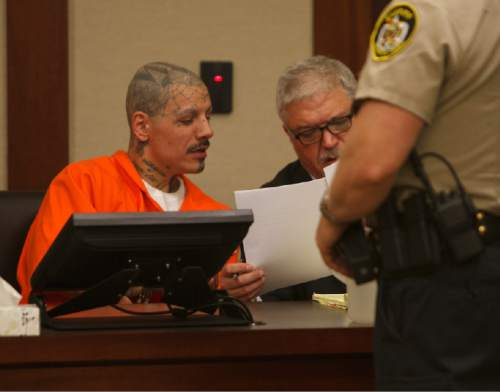 Jud Burkett  |  Pool Photo   Mario Antoine Lucero looks over evidence with his attorney Edward Flint during Lucero's preliminary hearing on charges of first-degree felony murder and third-degree felony assault in Fifth District Court Thursday, Sep. 18, 2014.