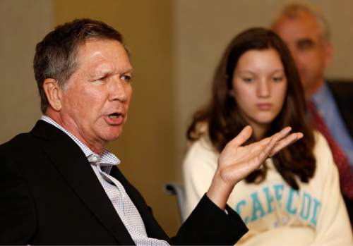 Ohio Gov. John Kasich, R-Ohio speaks during a luncheon with area business leaders, Thursday, June 4, 2015, in Portsmouth, N.H. Kasich is testing the waters as he considers running for the Republican nomination for president.  (AP Photo/Jim Cole)