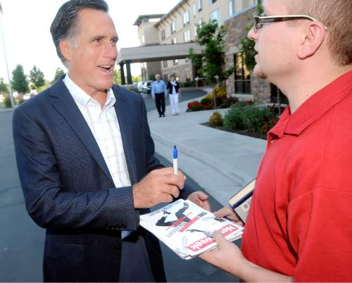 Republican presidential candidate Mitt Romney, left, refuses to sign a copy of Newsweek, that he appears on the cover, for Nick Rust outside of a fundraising event at the Riverwoods Conference Center Friday evening in Logan. (Eli Lucero/Herald Journal)