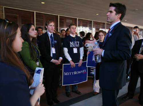 Courtesy  |  Abby Brack  Tagg Romney talks to college students who have gathered to greet Governor Mitt Romney following his address at CPAC in Washington DC March 2, 2007.j=