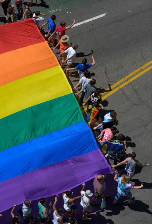 Francisco Kjolseth  |  The Salt Lake Tribune The large rainbow flag closes out the Pride Parade, Utah's second-largest parade, after the Days of '47, and by far the most colorful, as it is marched through the streets of downtown Salt Lake on Sunday, June 7, 2015.