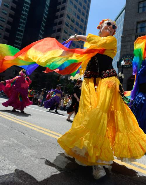Francisco Kjolseth  |  The Salt Lake Tribune Julia Breault twirls away for the Pride Parade, Utah's second-largest parade, after the Days of '47, and by far the most colorful, on the streets of downtown Salt Lake on Sunday, June 7, 2015.