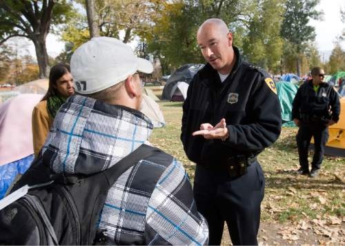 Al Hartmann  |  The Salt Lake Tribune  Salt Lake City Police Chief Chris Burbank reasons with members of the Occupy Salt Lake in Pioneer Park Friday afternoon November 11, 2011. He announced to occupiers that the camp would have to be dismantled and vacated by sundown on Saturday due to a death in the camp earlier on Friday morning and public safety concerns.