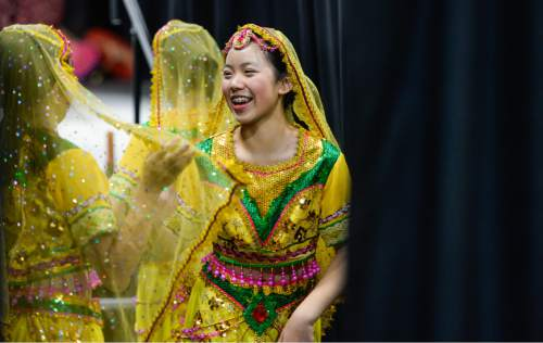 Francisco Kjolseth  |  The Salt Lake Tribune Megan Zeng, 13, with the Leah Dance Company gets ready to take to the stage for the 38th Annual Asian Festival that celebrates Asian cultures with dance, music, food and more at the South Towne Expo Center on Saturday, June 13, 2015. This year the festival features Utah's Bhutanese, Cambodian, Chinese, Filipino, Indian, Indonesian, Japanese, Korean, Laotian, Taiwanese, Thai, Tibetan and Vietnamese communities.