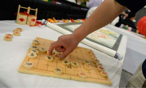 Francisco Kjolseth  |  The Salt Lake Tribune People play a friendly game of Chinese chess during the 38th Annual Asian Festival that celebrates Asian cultures with dance, music, food and more at the South Towne Expo Center on Saturday, June 13, 2015. This year the festival features Utah's Bhutanese, Cambodian, Chinese, Filipino, Indian, Indonesian, Japanese, Korean, Laotian, Taiwanese, Thai, Tibetan and Vietnamese communities.