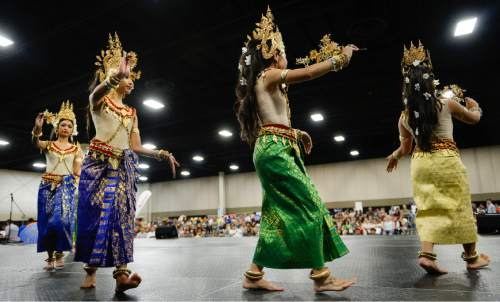 Francisco Kjolseth  |  The Salt Lake Tribune The Cambodian Khemera Dance Troupe takes to the stage for the 38th Annual Asian Festival that celebrates Asian cultures with dance, music, food and more at the South Towne Expo Center on Saturday, June 13, 2015. This year the festival features Utah's Bhutanese, Cambodian, Chinese, Filipino, Indian, Indonesian, Japanese, Korean, Laotian, Taiwanese, Thai, Tibetan and Vietnamese communities.