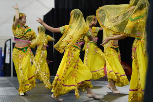 Francisco Kjolseth  |  The Salt Lake Tribune The Leah Dance Company performs on stage during the 38th Annual Asian Festival that celebrates Asian cultures with dance, music, food and more at the South Towne Expo Center on Saturday, June 13, 2015. This year the festival features Utah's Bhutanese, Cambodian, Chinese, Filipino, Indian, Indonesian, Japanese, Korean, Laotian, Taiwanese, Thai, Tibetan and Vietnamese communities.