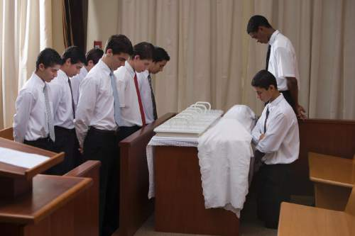 Courtesy  |  LDS Church  Young Latter-day Saint priesthood holders prepare, bless and pass the sacrament during Sunday worship services.