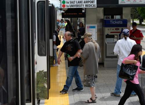 Scott Sommerdorf   |  The Salt Lake Tribune Riders exit and board a UTA TRAX train at the Courthouse Station in Salt Lake City, Thursday, June 11, 2015.