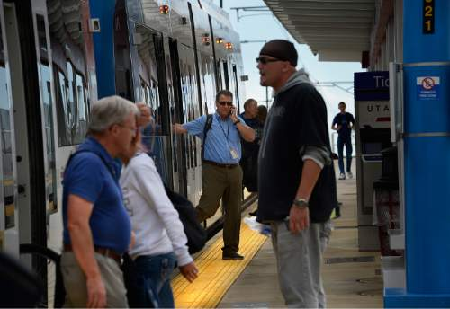 Scott Sommerdorf   |  The Salt Lake Tribune Riders get on and off a UTA TRAX train headed into Salt Lake City on North Temple, Thursday, June 11, 2015.