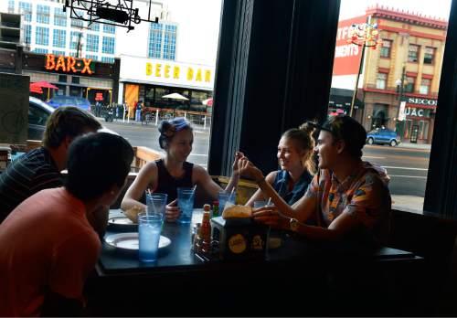 Scott Sommerdorf   |  Tribune file photo A group of millennial friends eat at Este in the Edison Quarter enclave of Salt Lake City Thursday, August 21, 2014.