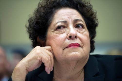 Office of Personnel Management (OPM) Director Katherine Archuleta testifies on Capitol Hill in Washington, Tuesday, June 16, 2015, before the before the House Oversight and Government Reform Committee hearing on the OPM data breach. In the cyberattack targeting federal personnel records, hackers are believed to have obtained the Social Security numbers, birth dates, job actions and other private information on every federal employee and millions of former employees and contractors. (AP Photo/Cliff Owen)