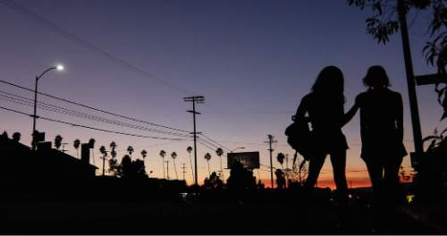"This photo provided by courtesy of the Sundance Institute shows a scene from the film, ""Tangerine,"" directed by Sean Baker. (AP Photo/Sundance Film Institute)"