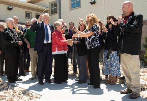 Rick Egan  |  The Salt Lake Tribune  The ribbon is cut during the ribbon cutting ceremony of the new Lantern House homeless shelter in Ogden, Tuesday, June 16, 2015.