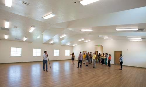 Rick Egan     The Salt Lake Tribune  Justine Murray leads a tour of the new women's dormitory, in the new Lantern House homeless shelter in Ogden, Tuesday, June 16, 2015.