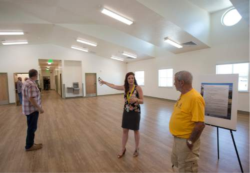 Rick Egan  |  The Salt Lake Tribune  Justine Murray leads a tour of the new women's dormitory in the new Lantern House homeless shelter in Ogden, Tuesday, June 16, 2015.