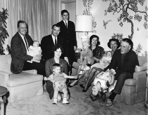Tribune file photo  The regional caption on this 1962 photo says: An informal portrait of Mr. and Mrs. George Romney, their two daughters, sons-in-law, at their home in Bloomfield Hills, Mich. LEFT TO RIGHT:, in back: Son-in-law Larry Keenan holding daughter Susan, two months; son-in-law Bruce Robinson; son Mitt, 14; daughter Lynn Keenan holding son Brett, 2; Mrs. Lenore Romney holding grandson Douglas Robinson, two months; and George Romney with granddaughter Jody Keenan,3. IN FRONT, daughter Jane Robinson with son Gregory, one. Missing is the Romney's son Scott, a Mormon missionary in England.